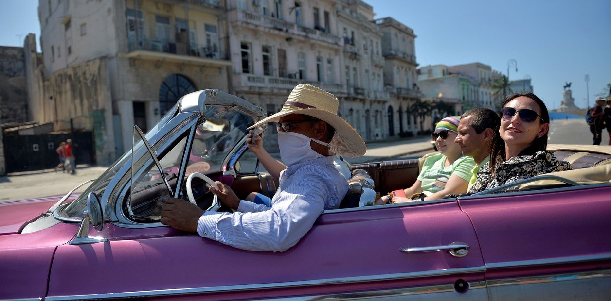 Rides in vintage cars for tourists in Havana, Cuba.