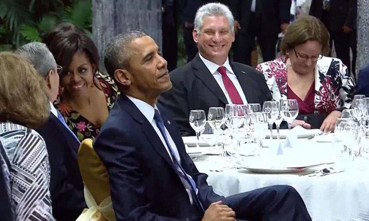 Miguel Díaz-Canel laughs while dining with Barack Obama in Cuba in 2016.