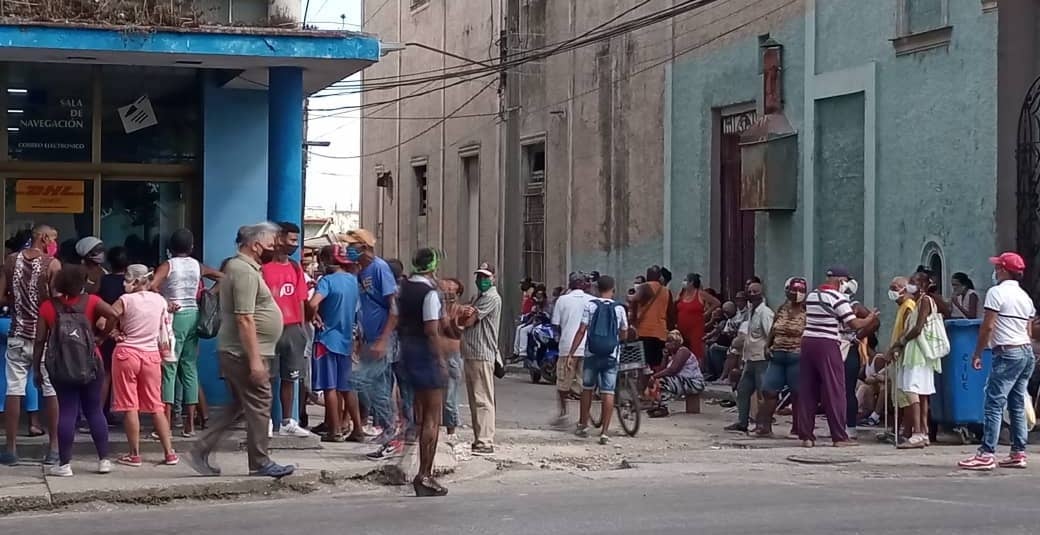 Cubans waiting in line to collect their pensions in Havana.