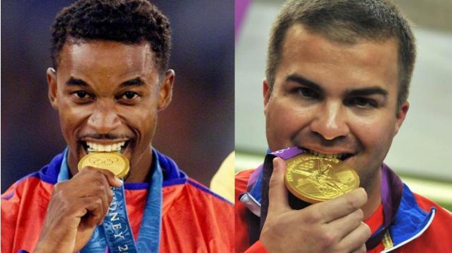 Iván Pedroso y Leuris Pupo con sus medallas de oro.